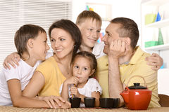 Happy parents with children  at home Stock Images