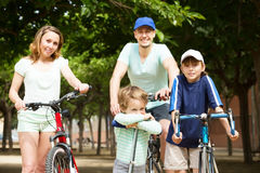 Happy parents with children in park Stock Photography