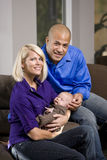 Happy parents cradling sleeping baby at home. Happy parents cradling sleeping 3 month old baby at home Stock Photography