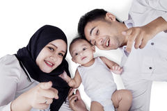 Happy parents and cute baby lying in studio Royalty Free Stock Photo