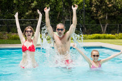 Happy parents and daughter having fun in pool Royalty Free Stock Images