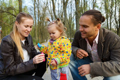 Happy parents with daughter outdoor Stock Image