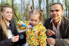 Happy parents with daughter outdoor Stock Photography