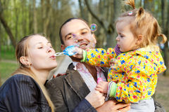 Happy parents with daughter outdoor Royalty Free Stock Image