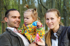 Happy parents with daughter outdoor Royalty Free Stock Photo