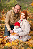 Happy parents. Father, mother and little daughter Royalty Free Stock Image
