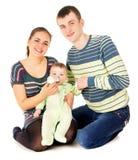 Happy the parents feeds baby Stock Photo