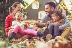 Happy parents have play with children outside. Autumn season. royalty free stock images