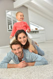 Happy parents with her baby daughter at home Stock Image