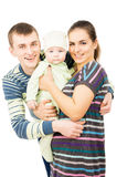 Happy parents holding the hands of his baby Stock Photography