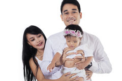Happy parents holding their daughter Stock Photos