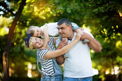 Happy parents holding their son Royalty Free Stock Photos
