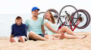 Happy parents with kid on the beach Royalty Free Stock Photo