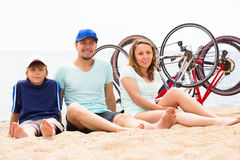 Happy parents with kid on sandy beach Royalty Free Stock Image