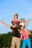 Happy parents with kids Stock Photo