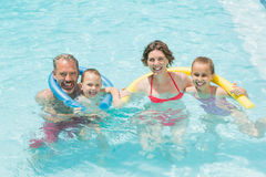 Happy parents and kids having fun in pool Stock Photo