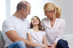 Happy parents with little daughter at home Royalty Free Stock Image
