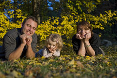 Happy parents and little girl. Portrait with happy parents and little girl in the parc Stock Image