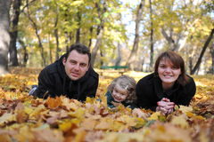 Happy parents and little girl. Portrait with happy parents and little girl in the parc Stock Photo