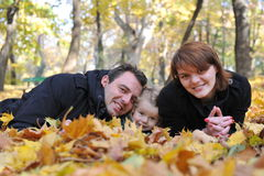 Happy parents and little girl. Portrait with happy parents and little girl in the parc Stock Images