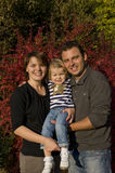 Happy parents and little girl. Portrait with happy parents and little girl in the park Stock Photography