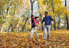 Happy parents and little girl. Portrait with happy parents and little girl playing in the parc Stock Photography