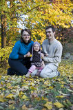 Happy parents and little girl. Portrait with happy parents and little girl in the parc Royalty Free Stock Photo