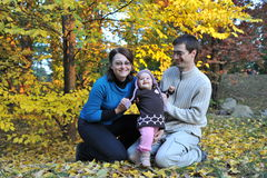 Happy parents and little girl. Portrait with happy parents and little girl in the parc Royalty Free Stock Images