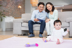 Happy parents looking at their baby daughter Stock Photo