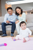 Happy parents looking at their baby daughter Royalty Free Stock Image