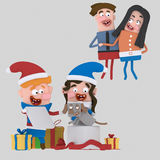Happy parents looking their sons opening gifts Royalty Free Stock Photo