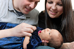 Happy Parents with a Newborn Infant Stock Photography
