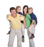 Happy parents piggybacking children Stock Image