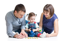 Happy parents play with kid Stock Image