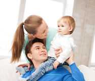 Happy parents playing with adorable baby Royalty Free Stock Photography