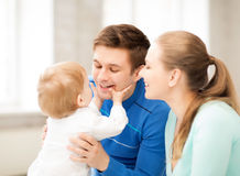 Happy parents playing with adorable baby Royalty Free Stock Images