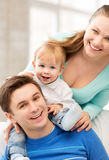 Happy parents playing with adorable baby Royalty Free Stock Photos