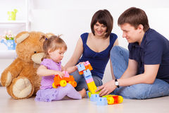 Happy parents playing with child at home Royalty Free Stock Images