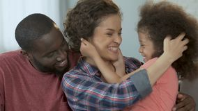Happy parents playing daughter spending time together, family values, childcare. Stock footage stock footage
