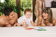 Happy parents playing with little daughter Royalty Free Stock Image