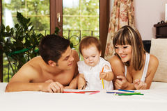 Happy parents playing with little daughter Stock Photo
