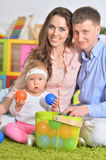 Happy parents playing with little daughter Royalty Free Stock Photo