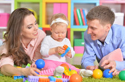 Happy parents playing with little daughter Royalty Free Stock Images