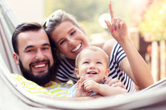 Happy parents playing with their baby boy in hammock Stock Image