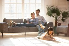 Free Happy Parents Relaxing On Couch While Kid Drawing On Floor Royalty Free Stock Photo - 139193715