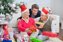 Happy Parents And Son With Christmas Presents Royalty Free Stock Image