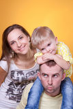 Happy parents with son on father's shoulders Royalty Free Stock Photos