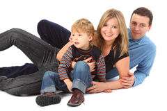 Happy parents with son laying Stock Images