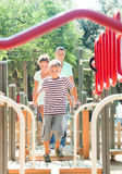 Happy parents with teenage son overcomes the obstacle course Royalty Free Stock Photography