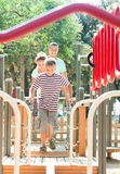 Happy parents with teenage son overcoming obstacle course Royalty Free Stock Images